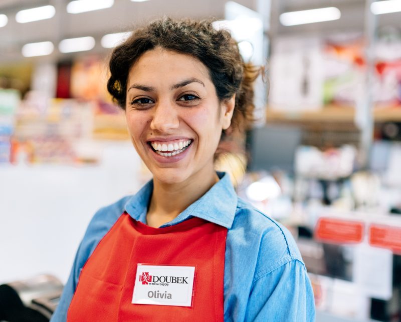 Friendly Smiling Female Doubek Team Member